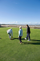 Bowlers playing crown green bowls in Lancashire