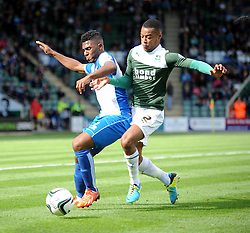 Bristol Rovers' Ellis Harrison under pressure from Plymouth Argyle's Durrell Berry  - Photo mandatory by-line: Dougie Allward/JMP - Tel: Mobile: 07966 386802 07/09/2013 - SPORT - FOOTBALL -  Home Park - Plymouth - Plymouth Argyle V Bristol Rovers - Sky Bet League Two