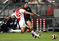 Photo: Maarten Straetemans.<br /> Arsenal v Ajax. LG Amsterdam Tournament. 04/08/2007.<br /> Van Persie (Arsenal) with Colin