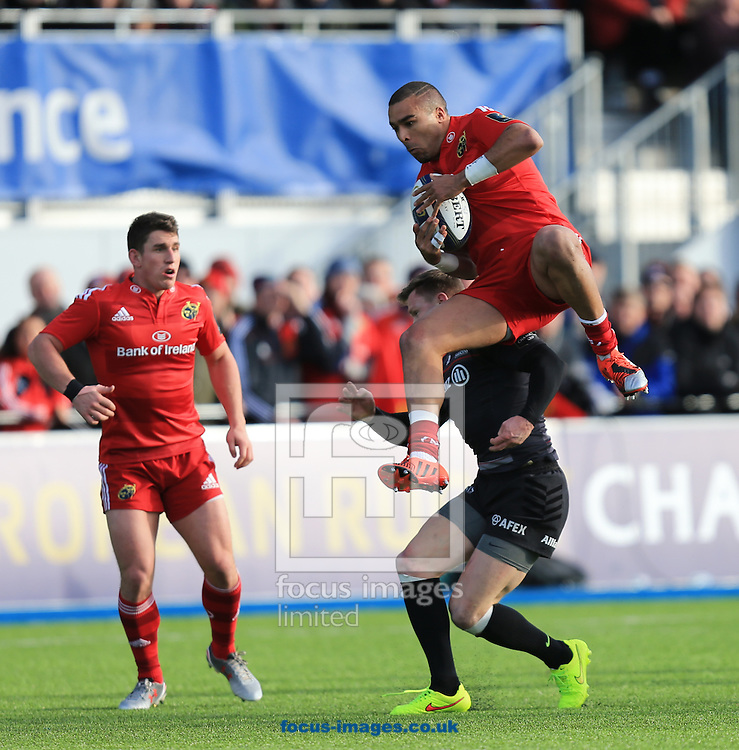 Chris Ashton of Saracens  clashes with Simon Zebo of Munster during the European Rugby Champions Cup match at Allianz Park, London<br /> Picture by Michael Whitefoot/Focus Images Ltd 07969 898192<br /> 17/01/2015