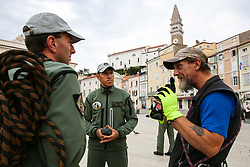 After two months of restoration, the Statue of Archangel Michael, made of copper plate, returned to Piran. The image shows Robert Grilc-Cevap talking with Jure Prezelj and Ales Hocevar of 151st Rotary Wing Squadron before helicopter placing it on top of the church's clock, on October 15, 2018 in Piran, Slovenia. Photo by Matic Klansek Velej / Sportida