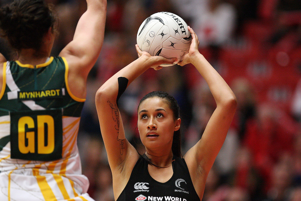 New Zealand's Maria Tutaia attempts a shot at goal against South Africa in the New World Quad series netball match, TECT Arena, Tauranga, New Zealand, Sunday, October 28, 2012. Credit:SNPA / Dianne Manson.