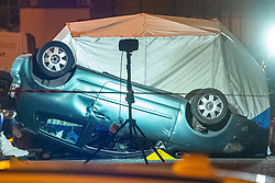 © Licensed to London News Pictures. 23/07/2020. Thame, UK. An overturned car on Chinnor Road and a police forensic tent are illuminated by flood lights. Thames Valley Police has launched a murder investigation in Thame. At approximately  19:05BST a man was found with injuries in Chinnor Road, Thame. The 20-year-old man was pronounced dead at the scene. Photo credit: Peter Manning/LNP