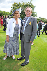 The DUCHESS OF RICHMOND & GORDON and LORD ANDREW LLOYD-WEBBER at the 3rd day of the 2011 Glorious Goodwood Racing Festival - Ladies Day at Goodwood Racecourse, West Sussex on 28th July 2011.