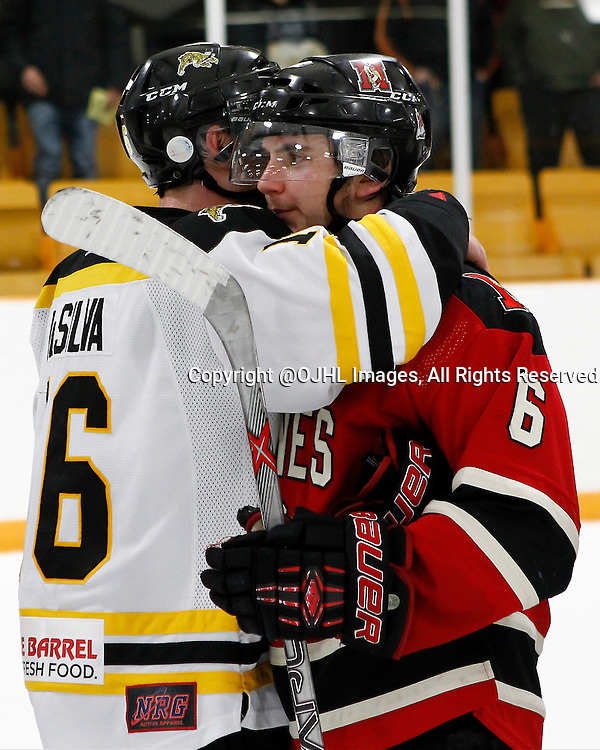 AURORA, ON - Mar 6, 2015 : Ontario Junior Hockey League game action between the Aurora Tigers and the Newmarket Hurricanes.  Game five of the best of seven series, Jordan DaSilva #16 and Curtis Harvey #6 after the game.<br /> (Photo by Brian Watts / OJHL Images)