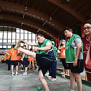 Italy, Biella- XVIII Special Olympics National Games for mentally disabled people: some stratching before a bowles competition. ©2012 Mama2
