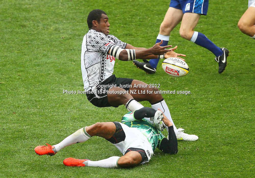 Fiji's Nemani Nagusa offloads the ball as South Africa's Cornal Hendricks makes the tackle. Hertz Wellington Sevens - Day two at Westpac Stadium, Wellington, New Zealand on Saturday, 4 February 2012. Photo: Justin Arthur / photosport.co.nz