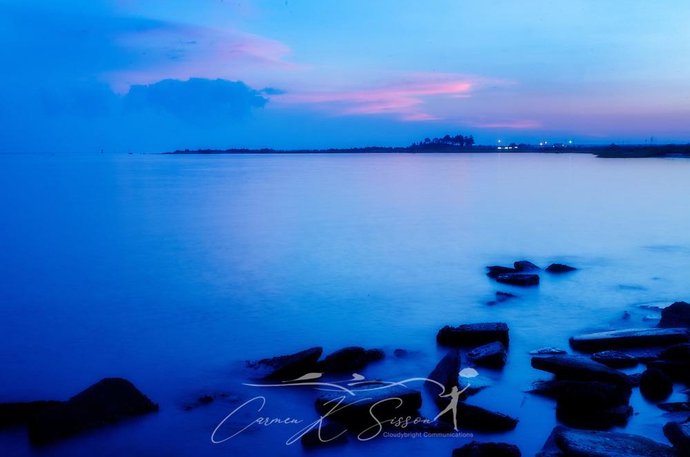 The sun sets on Bayou La Batre Beach in Alabama on June 14, 2013. (Photo by Carmen K. Sisson/Cloudybright)