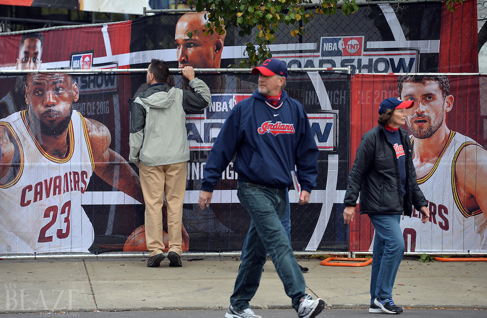 Oct 25, 2016; Cleveland, OH, USA; Fans of the Cleveland Indians walk past a print of Cleveland Cavaliers player LeBron James before game one of the 2016 World Series against the Chicago Cubs at Progressive Field. Mandatory Credit: Ken Blaze-USA TODAY Sports