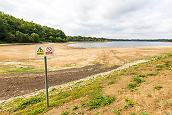 © Licensed to London News Pictures. 23/07/2018. Alwoodley UK. Eccup reservoir in Alwoodley is usually the largest area of water in west Yorkshire with an open water area of 91 hectares, but scenes this morning show the extent the water level has dropped since the UK heatwave began. Photo credit: Andrew McCaren/LNP