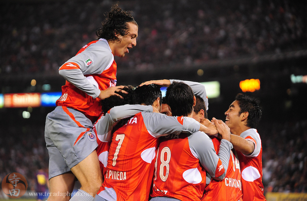 August 8, 2009; San Francisco, CA, USA; Chivas de Guadalajara defender Hector Reynoso (far left) jumps onto his teammates in celebration of midfielder Ramon Morales (not pictured) scoring a goal during the second half against FC Barcelona in the Night of Champions international friendly contest at Candlestick Park. The game ended in a 1-1 tie.