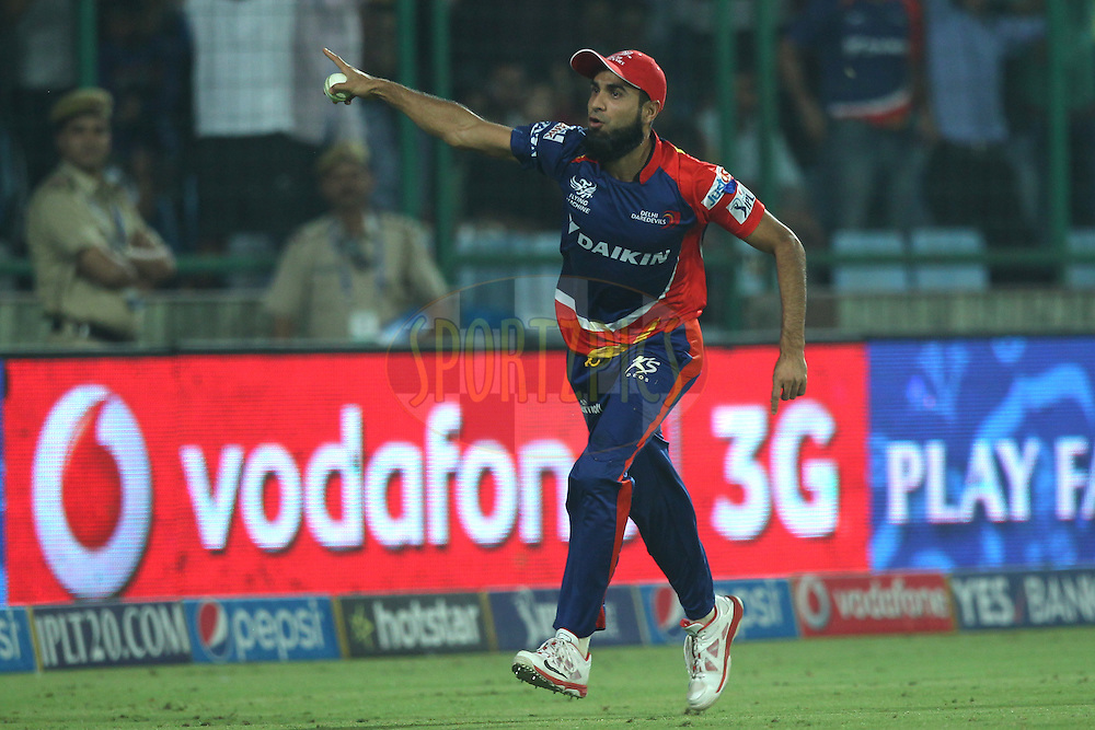 Imran Tahir of the Delhi Daredevils celebrates the wicket of Parthia Patel of the Mumbai Indians  during match 21 of the Pepsi IPL 2015 (Indian Premier League) between The Delhi Daredevils and The Mumbai Indians held at the Ferozeshah Kotla stadium in Delhi, India on the 23rd April 2015.<br /> <br /> Photo by:  Deepak Malik / SPORTZPICS / IPL