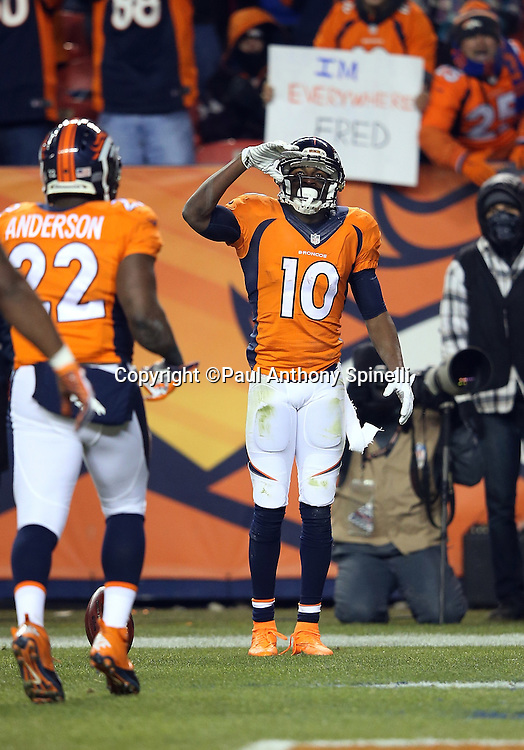 Denver Broncos wide receiver Emmanuel Sanders (10) salutes after catching a pass during the 2015 NFL week 16 regular season football game against the Cincinnati Bengals on Monday, Dec. 28, 2015 in Denver. The Broncos won the game in overtime 20-17. (©Paul Anthony Spinelli)
