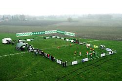 19-11-2008 VOETBAL: NEDERLAND - BELGIE: BAARLE HARTOG<br /> De grens van Nederland en Belgie was vandaag het strijdtoneel van een ludieke actie. De wedstrijd van 23 jaar geleden werd opnieuw gespeeld op het grensgebied Baarle Hartog / voetbalveld met unibet reklame - voetbal item creative illustratief<br /> &copy;2008-WWW.FOTOHOOGENDOORN.NL