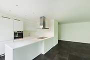 interior of new apartment, white domestic kitchen