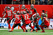 Tampa Bay Buccaneers Running BackRonald Jones (27) celebratres his touchdown with his team mates during the International Series match between Tampa Bay Buccaneers and Carolina Panthers at Tottenham Hotspur Stadium, London, United Kingdom on 13 October 2019.