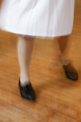 Womans feet dancing in a Line Dancing Class,