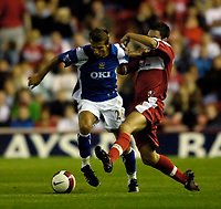 Photo: Jed Wee.<br /> Middlesbrough v Portsmouth. The Barclays Premiership. 28/08/2006.<br /> <br /> Middlesbrough's Stewart Downing (R) tries to tackled Portsmouth's Gary O'Neil.