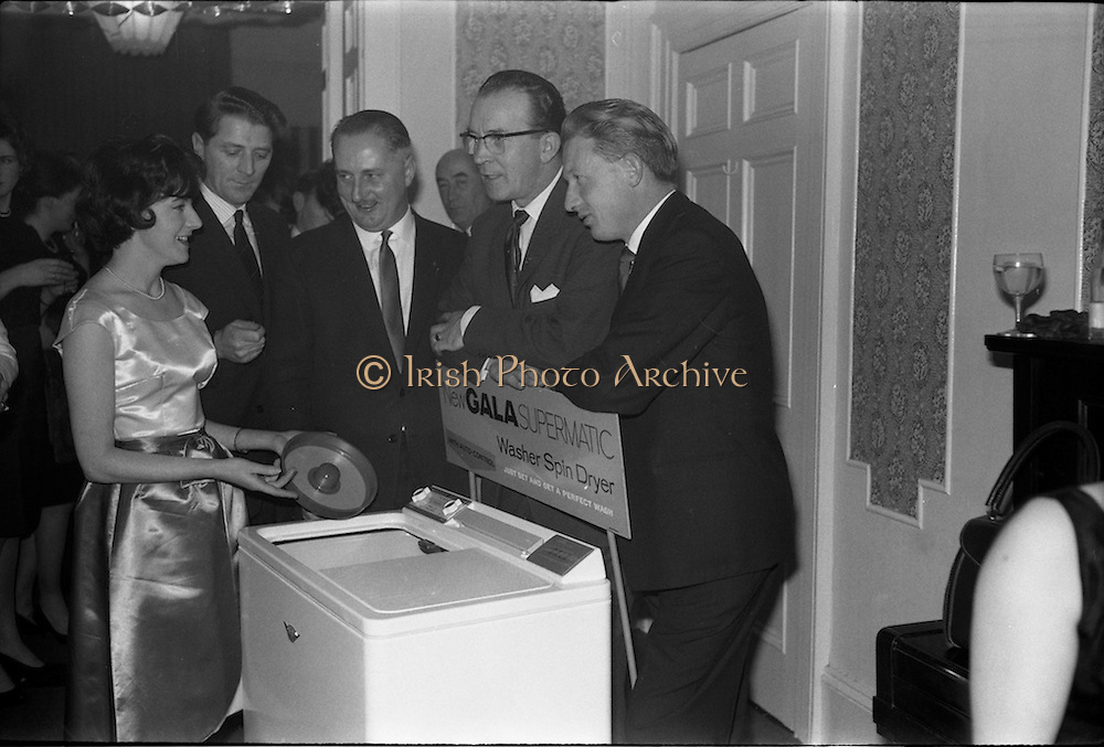 17/12/1962<br /> 12/17/1962<br /> 17 December 1962<br /> A.E.I. Gala reception at Shangri-la Hotel, Dalkey, Dublin, where a Gala Supermatic washing machine was presented to the Variety Club of Ireland for their Easter Draw by Gala. Pictured are Gala Demonstrator Miss Patricia Kavanagh, showing the prize to (from left) Mr. Pat Cunningham (Sales manager, Dorothy Gray Ltd.); Mr. Des O'Keeffe, Chief Barker, Variety Club of Ireland and Mr. Jack Cruise. On right is Mr. P.N. Walsh, Area Manager for Ireland, A.E.I. Gala.