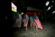 """American fans make their way through the halls of the the National Stadium, also known as the """"Bird's nest"""" in Beijing , China, Saturday, Aug.16, 2008. It is one of the strangest things about the Olympics: From far away, it looks very close. Watching the Olympics on television, the athletes are right in front of you.  Up close, though, it's normally a different story. From the spectators' stands, the athletes are often just distant specks amid the enormity of some of the largest sports stadiums in the world. (Elizabeth Dalziel)"""
