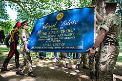© Licensed to London News Pictures. 03/06/2019. London, UK. A sign announcing the Royal Salute fired by the King's Troop to celebrate the Anniversary of the Queen's Coronation and the State Visit of President of the United States Donald Trump is put out in Green Park. President Trump is in the UK for a three-day State Visit. Photo credit: Rob Pinney/LNP