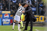 Udinese forward Fabio Quagliarella (L) holds Jose Muorinho during their Serie A round of 30 football match on April 5, 2009 in Udine.