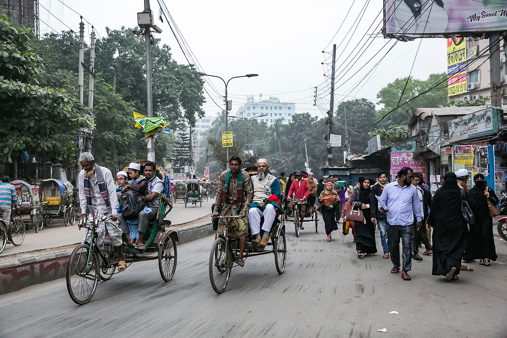INDIVIDUAL(S) PHOTOGRAPHED: N/A. LOCATION: Dhaka, Bangladesh. CAPTION: A busy street in Dhaka, Bangladesh bustles with people and rickshaws.