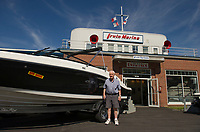 Jack Irwin stands outside the entrance of Irwin Marine on Lake Winnipesaukee in Laconia, NH.  (Karen Bobotas for New England Boating Magazine)