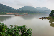 Morning scene along the Mekong River where the Nam Khan River enters, Luang Prabang, Laos.