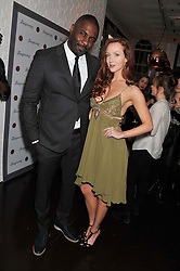 IDRIS ELBA and OLIVIA GRANT at the opening of the 'pop up' Tanqueray Gin Palace hosted by Idris Elba at 13 Floral Street, Covent Garden, London on 26th March 2013.