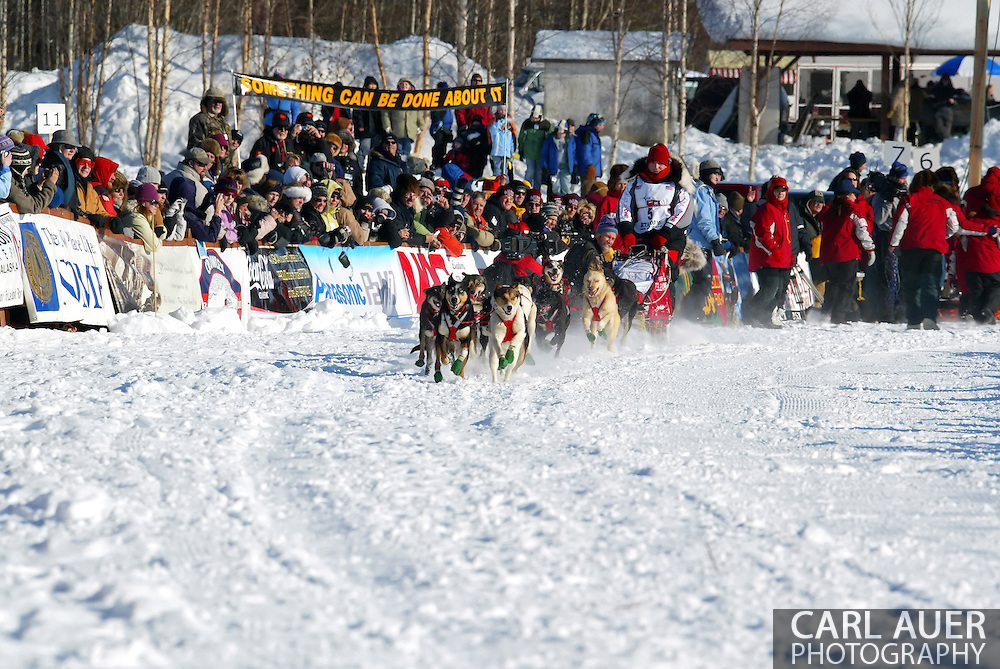 3/4/2007:  Willow, Alaska -  Local fan favorite, Veteran Ramy Brooks of Healy, AK is lead out of the start on Willow Lake by his dog team at the official restart of the 35th Iditarod Sled Dog Race