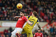 Swindon Town Defender, Raphael Rossi Branco (29) and Oxford United Forward, Chris Maguire (10) challenge for the ball during the EFL Sky Bet League 1 match between Swindon Town and Oxford United at the County Ground, Swindon, England on 5 February 2017. Photo by Adam Rivers.