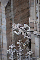 Milan, Italy, Duomo Cathedral - stone dragon gargoyle.