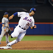Michael Conforto, New York Mets, rounds third base to score a run for the Mets during the New York Mets Vs Los Angeles Dodgers MLB regular season baseball game at Citi Field, Queens, New York. USA. 25th July 2015. Photo Tim Clayton