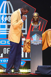 August 4, 2018 - Canton, OH, U.S. - CANTON, OH - AUGUST 04:  Randy Moss reacts to his Bust after the unveiling during the 2018 Hall of Fame Enshrinement Ceremony on August 4, 2018 at the Tom Benson Hall of Fame Stadium in Canton, Ohio  (Photo by Rich Graessle/Icon Sportswire) (Credit Image: © Rich Graessle/Icon SMI via ZUMA Press)