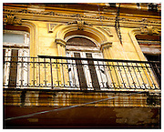 Yellow building with balcony, Havana, Cuba.