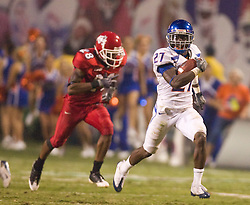 Sep. 18, 2009; Fresno, CA, USA; Boise State Broncos running back Jeremy Avery (27) rushes past Fresno State Bulldogs cornerback A.J. Jefferson (28) on a 67 yard reception for a touchdown during the fourth quarter at Bulldog Stadium. Boise State defeated Fresno State 51-34.
