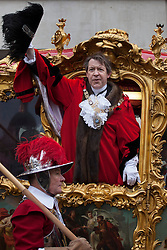 © licensed to London News Pictures. London, UK 10/11/2012. The 685th Lord Mayor of London, Alderman Roger Gifford waving in the State Coach, after swearing loyalty to the Crown on 10/11/12. This year's procession is over three and a half miles long and includes over 6500 people, 22 marching bands, 125 horses, 18 vintage cars and 21 carriages. Photo credit: Tolga Akmen/LNP