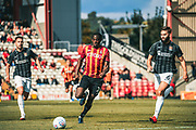Clayton Donaldson of Bradford City runs from Jordan Turnbull of Northampton Town during the EFL Sky Bet League 2 match between Bradford City and Northampton Town at the Utilita Energy Stadium, Bradford, England on 7 September 2019.