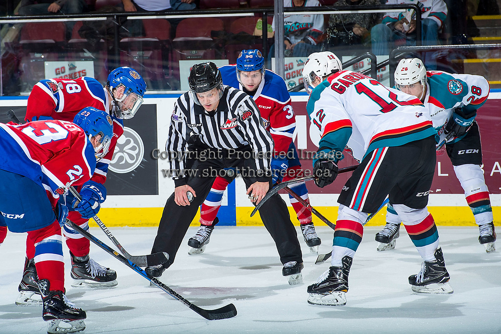 KELOWNA, CANADA - FEBRUARY 17:  Linesman, Dustin Minty stands at the face off between Kobe Mohr #18 of the Edmonton Oil Kings and Erik Gardiner #12 of the Kelowna Rockets on February 17, 2018 at Prospera Place in Kelowna, British Columbia, Canada.  (Photo by Marissa Baecker/Shoot the Breeze)  *** Local Caption ***