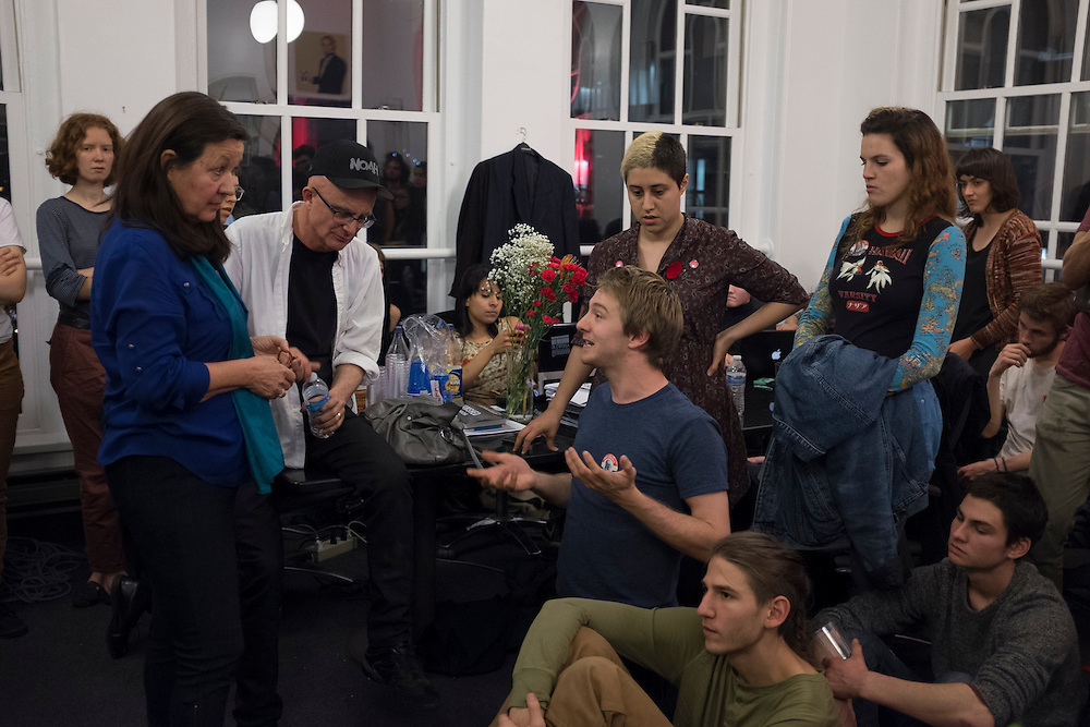 Students listen to Associate Dean of the Yale School of Art, Sam Messer (third from left, white shirt and black hat) inside the office of Cooper Union's president, Jamshed Bharucha in New York, NY, on Thursday, May 9, 2013. Over 50 students began a sit-in Wednesday inside the office of the school's president, Jamshed Bharucha, calling for his resignation...Photograph by Andrew Hinderaker.