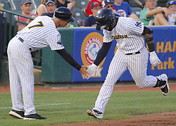 May 19, 2017 - Trenton, New Jersey, U.S - GLEYBER TORRES (right), an infielder for the Trenton Thunder, is congratulated by Thunder manager BOBBY MITCHELL as Torres heads toward home following his third-inning grand slam versus the Portland Sea Dogs at ARM & HAMMER Park. (Credit Image: © Staton Rabin via ZUMA Wire)