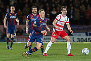 Bradford City midfielder Callum Guy and Doncaster Rovers forward John Marquis challenge for the ball during the EFL Sky Bet League 1 match between Doncaster Rovers and Bradford City at the Keepmoat Stadium, Doncaster, England on 19 March 2018. Picture by Aaron  Lupton.