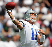 OAKLAND, CA - OCTOBER 2:  Quarterback Drew Bledsoe #11 of the Dallas Cowboys grimaces while unloading a pass against the Oakland Raiders at McAfee Coliseum in Oakland, California on October 2, 2005. The Raiders defeated the Cowboys 19-13. ©Paul Anthony Spinelli *** Local Caption *** Drew Bledsoe