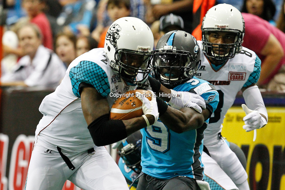 August 10, 2012; New Orleans, LA, USA; Arizona Rattlers wide receiver Maurice Purify (2) breaks a tackle and runs for a touchdown past Philadelphia Soul defensive back Kent Richardson (9) in ArenaBowl XXV at the New Orleans Arena. The Arizona Rattlers defeated the Philadelphia Soul 72-54. Mandatory Credit: Derick E. Hingle-US PRESSWIRE