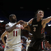 Steven Spieth, Brown, challenges for the rebound with K.J. Lee, (left), Marist, during the Marist vs Brown Men's College Basketball game in the Hall of Fame Shootout Tournament at Mohegan Sun Arena, Uncasville, Connecticut, USA. 22nd December 2015. Photo Tim Clayton