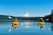 Woman and son kayaking at Timothy Lake, Mount Hood National Forest, Oregon.