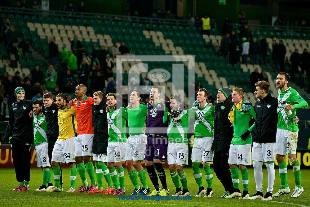 VfL Wolfsburg players celebrate their 2-0 victory over Sporting Clube de Portugal following the UEFA Europa League match at Volkswagen Arena, Wolfsburg<br /> Picture by Ian Wadkins/Focus Images Ltd +44 7877 568959<br /> 19/02/2015