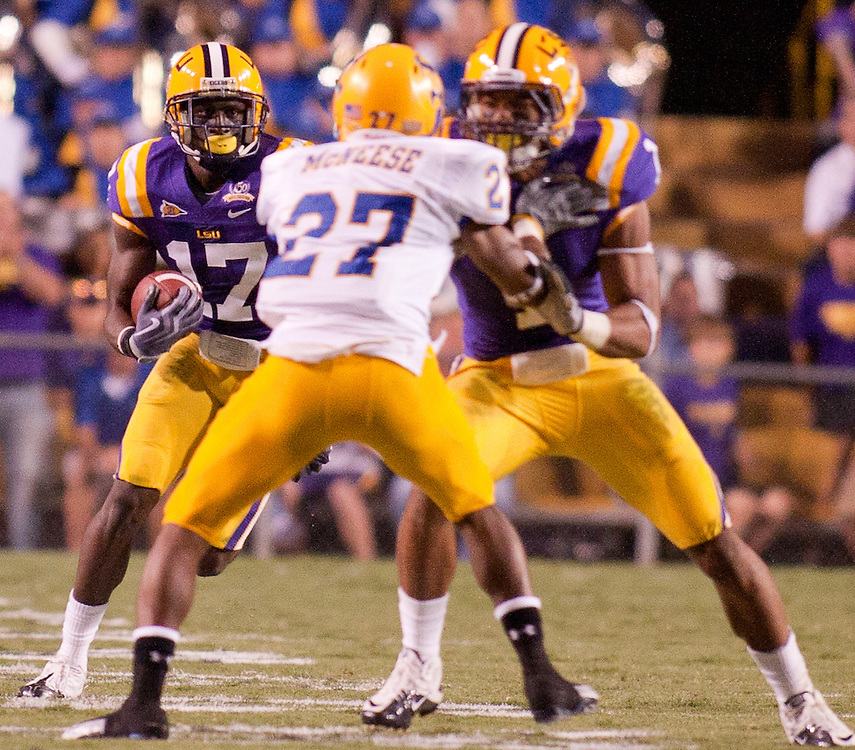 LSU Tigers cornerback Morris Claiborne (17) gets an interception from  Mcneese State Cowboys quarterback Blake Barousse (17) during the second half. LSU defeated Mcneese State Cowboys 32-10.
