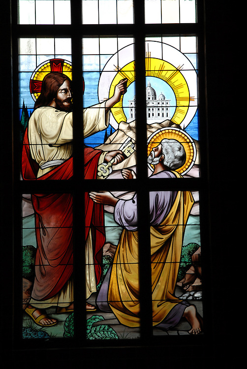 Stained glass image from St. William Church, Waukesha, depictings Jesus handing keys of church to St. Peter. (Photo by Sam Lucero)